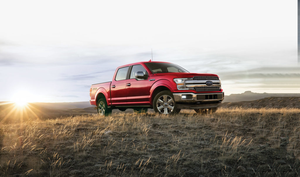 red 2020 Ford F-150 in a field | Tropical Ford Blog | Orlando, FL